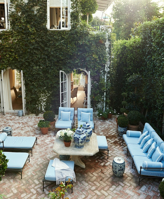 Mark D Sikes Outdoor patio design with ivy and blue and white furniture