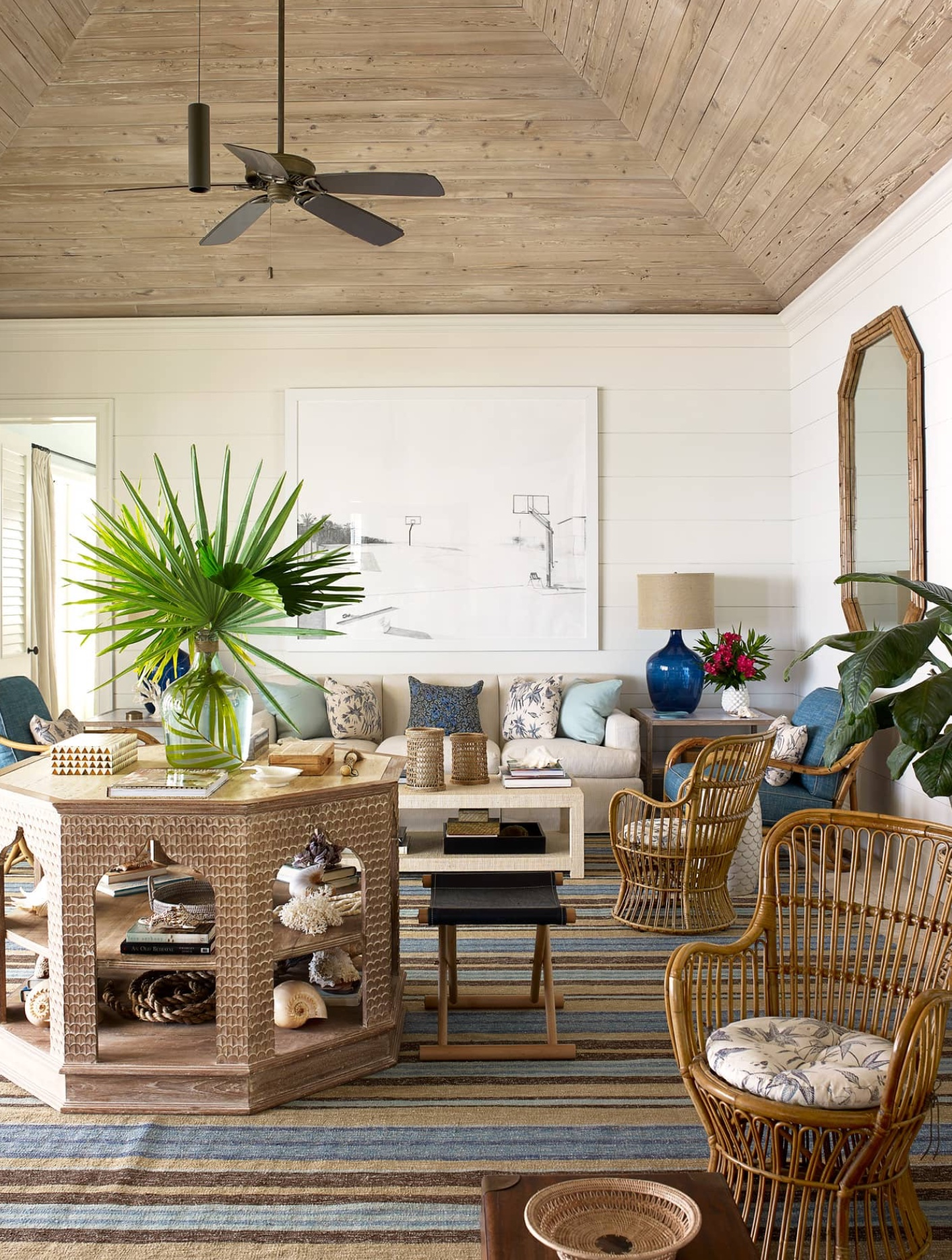 A Beach Home Decorated With Blue And Rattan Bahama Style